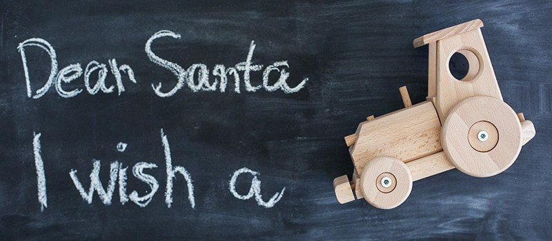 Dear Santa is written on a blackboard and christmas gift